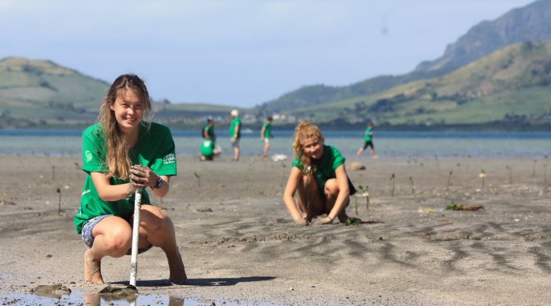 Students volunteering with Projects Abroad for their gap year help plant mangroves in Fiji, South Pacific.